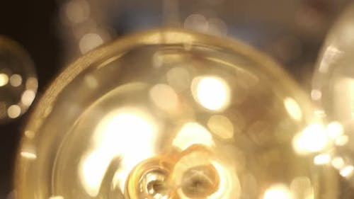 Expensive Large Chandelier Of Glass In A Restaurant Or Concert Hall. Chandelier Lighting In Hall