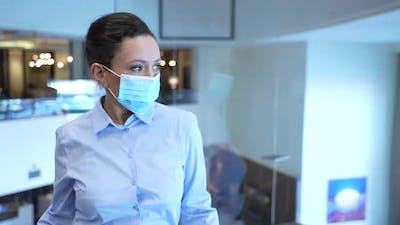 Businesswoman in Face Mask Taking Hotel Lift Up