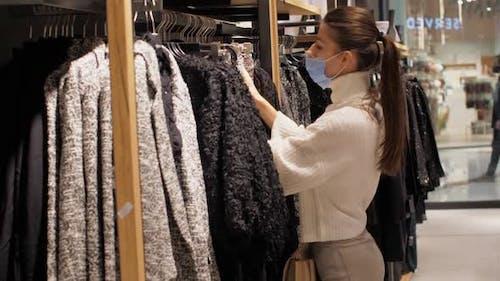 Slim Brunette Chooses Appropriate Size of Brown Woolen Skirt