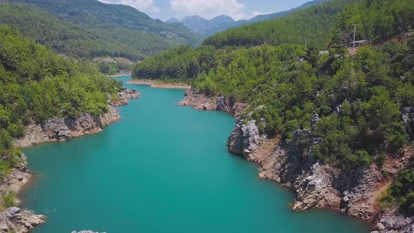 Long promontory stretches to the middle of turquoise lake