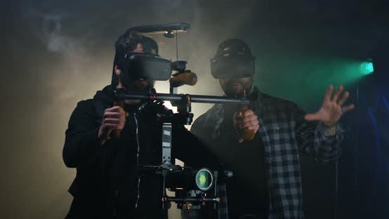 Thumbnail for Cameramen in VR Glasses Working on Film Set