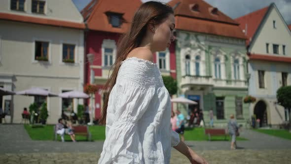 Townswoman of Small Slovakian Town Bardejov is Walking on Main Square