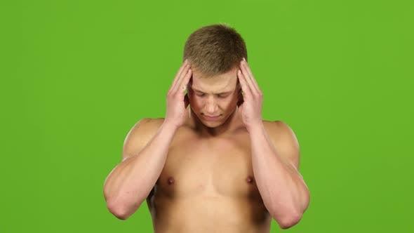 Thumbnail for Man with Headache Is Massages His Temples Hands, Green Screen