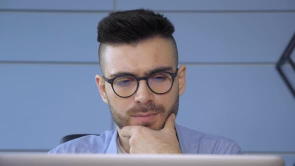 Close Up of A Young European Man with Glasses, Modern Guy Surfing Internet Use Laptop pc in Home