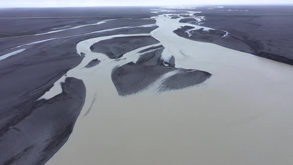 Thumbnail for Flying Over a Large Icelandic Glacial River System and Black Volcanic Sediments, Iceland