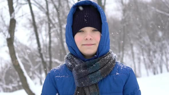 Thumbnail for Portrait of a Young Guy in the Winter Forest