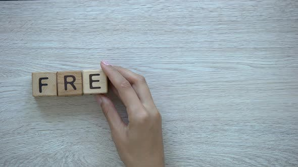 Thumbnail for Freelance Hand Putting Word on Wooden Cubes