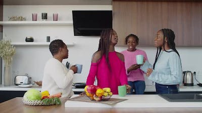 Joyful African Family Enjoying Leisure in Domestic Kitchen