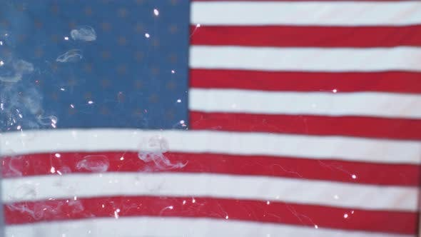 Thumbnail for Close up of fireworks and flag on Fourth of July