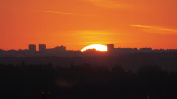 Thumbnail for Sun Going Down Behind the City Skyline