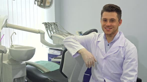 Thumbnail for Dentist Poses with Layout of Human Teeth