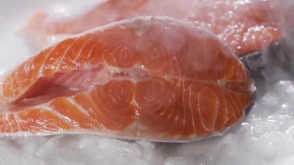 Thumbnail for Closeup of Slice of Red Fish on Ice in the Fish Market