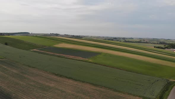 Aerial footage with flight over agricultural field.