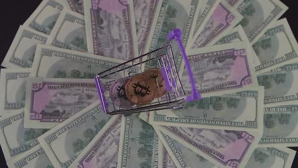 Thumbnail for Money Coin Bitcoin in a Small Cart Turns