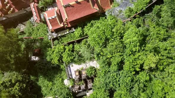 Thumbnail for Drone Flies Over Beautiful Buddhist Temple and Old Cemetery