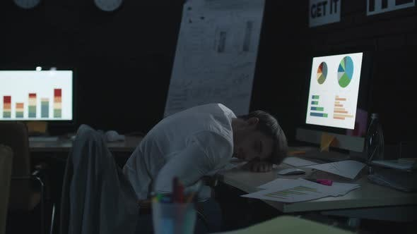 Thumbnail for Tired Businessman Sleeping on Work Table Front Computer in Dark Office.