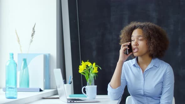 Thumbnail for Young Black Businesswoman Talking on Phone in Office