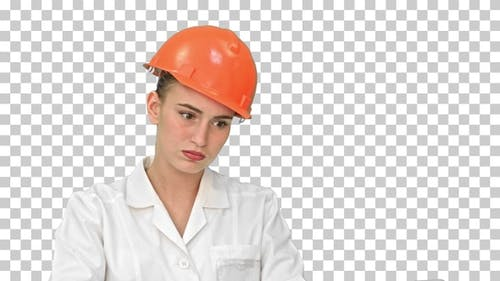 Stressed female engineer in helmet checking, Alpha Channel