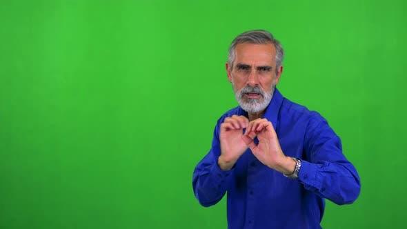 Thumbnail for Old Senior Man Does Karate - Green Screen - Studio