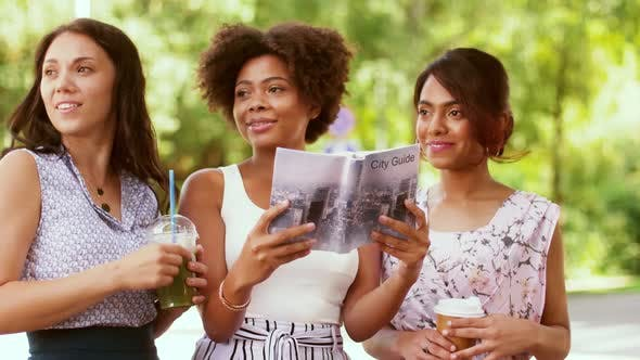 Thumbnail for Women with City Guide and Drinks on Street 40