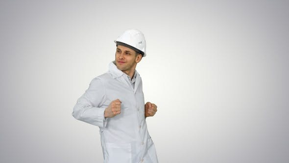 Thumbnail for Engineer man dancing in funny way on gradient background.