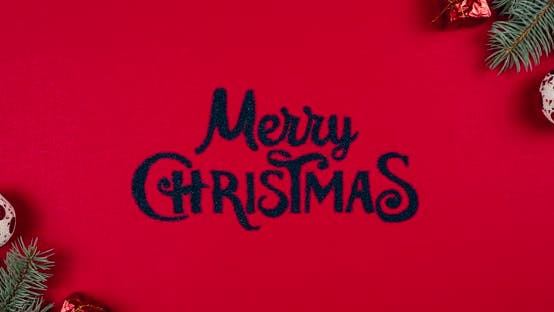 Merry Christmas lettering appears on red background