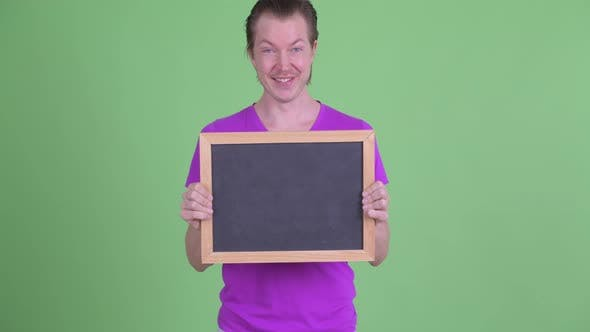 Thumbnail for Happy Young Handsome Man Holding Blackboard