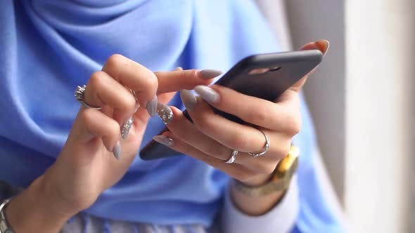 Thumbnail for Close-up of Luxurious Hands of Young Muslim Woman Using Smartphone. Slow Motion