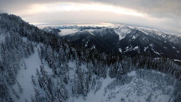 Cover Image for Snowy Mountain Ridge Aerial With Pristine Cascade Range Background
