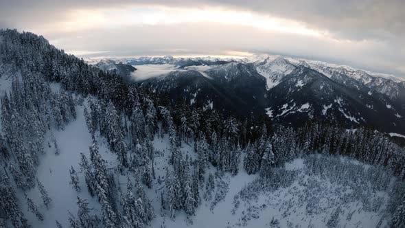 Thumbnail for Snowy Mountain Ridge Aerial With Pristine Cascade Range Background
