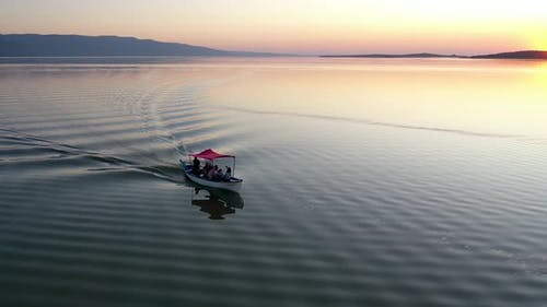 Fishing boat on lake at sunset golyazi, bursa turkey