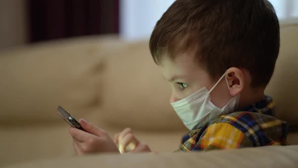 Thumbnail for Boy Medical Mask on Face Due To Coronavirus Outbreak.