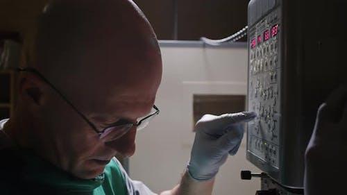 Vet Doctor Adjusting X-Ray Machine