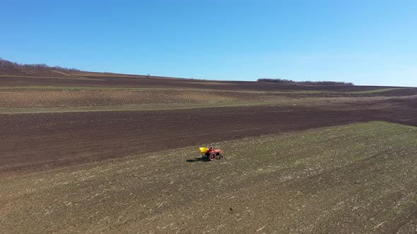 Thumbnail for Flying Over a Tractor Planting Seeds