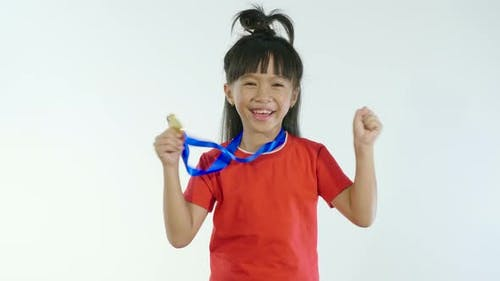 Little Girl Happy With Golden Medal