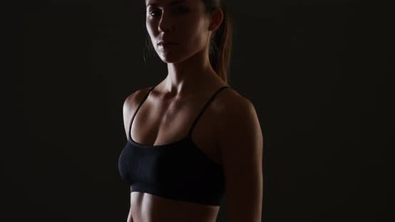 Thumbnail for Fit mixed race woman standing black background
