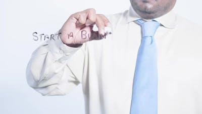 Latino Businessman Writes Start A Business