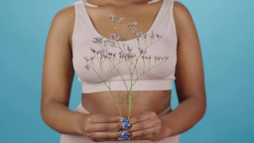 Curvy African-American Female with Wildflower