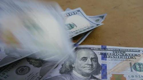 Rotating stock footage shot of $100 bills - MONEY 0143