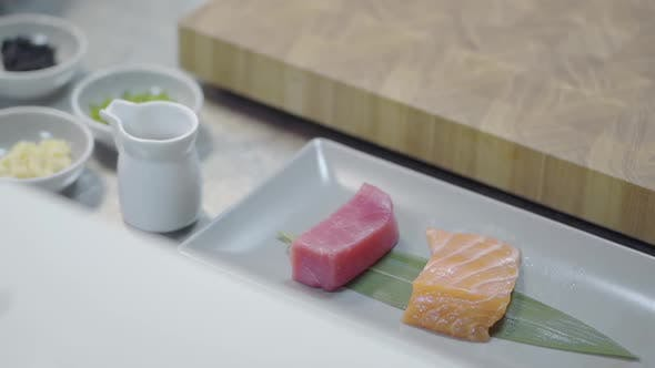 Thumbnail for Pieces of Tasty Salmon and Tuna Lying on the Long Plate in the Restaurant Kitchen