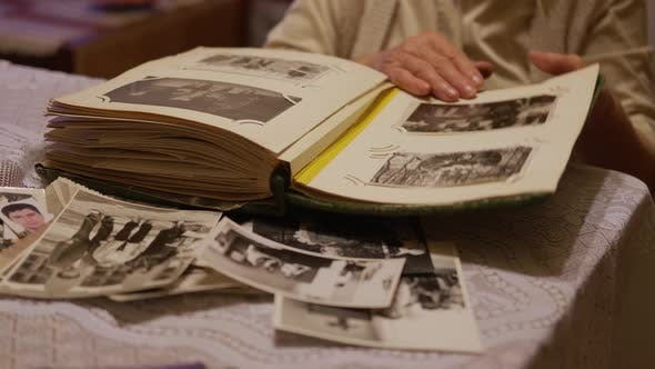 Thumbnail for Old Woman Is Looking at Old Photo Album at Home