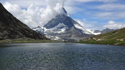Time-lapse view on snowy Matterhorn peak and lake Stellisee, Swiss Alps, Zermatt,