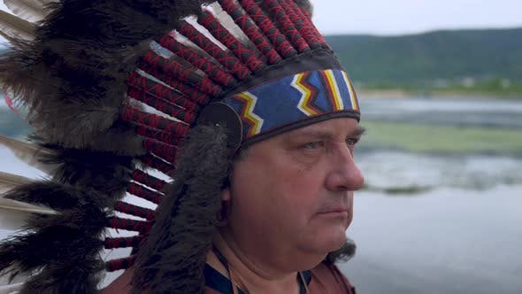 Thumbnail for Old Native American Indians Looks Into the Sunset. Background of the River. Clouse Up