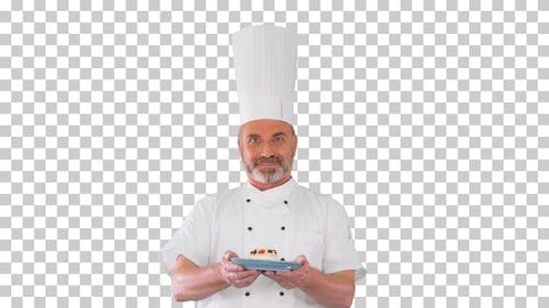 Happy chef looking at camera holding a dessert, Alpha Channel