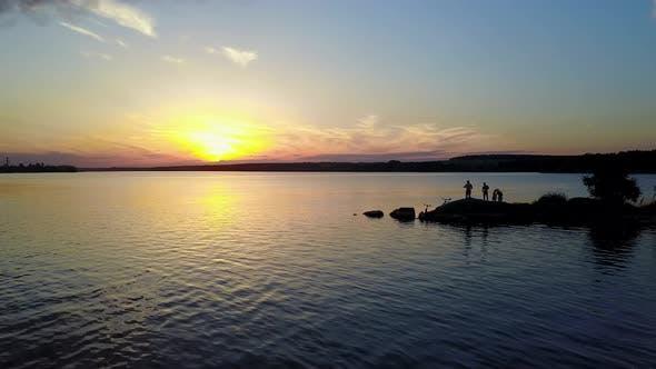 Thumbnail for People Enjoying the Riverside Sunset