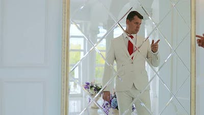 Groom Looks in the Mirror  Businessman Looks at His Reflection in the Mirror