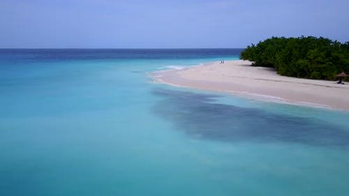 Daytime overhead clean view of a white sand paradise beach and aqua turquoise water background in hi