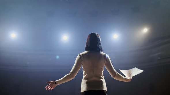Thumbnail for The Female Financial Coach Emotional Gesturing Talks From the Stage with Spectators at Forum. Too
