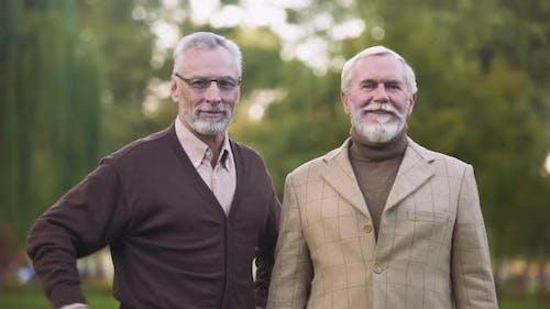 Elegant Old Men Looking Camera and Smiling