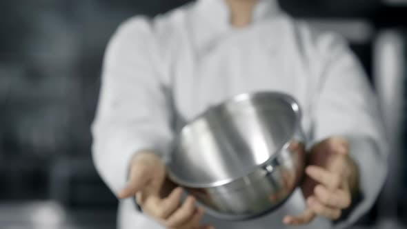 Thumbnail for Professional Chef Playing with Kitchen Tools. Close Up Chef Hands Rolling Bowl